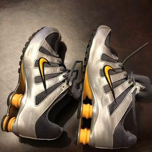 Nike shox yellow, gray & silver.